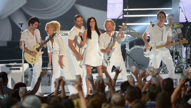 "Johnny ""Duke"" Lippincott (far left) performs with Little Big Town in 2014 at the CMT Music Awards in Nashville."