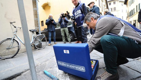 Italian police continue an investigation outside the