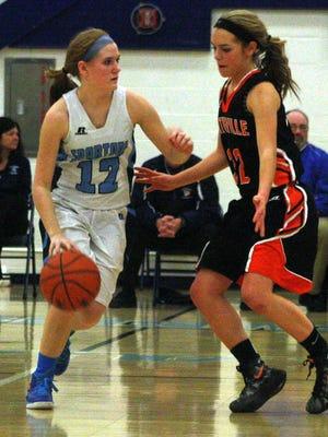 Northville's Jenna Lauderback applies air-tight defense to a Stevenson guard Friday night.