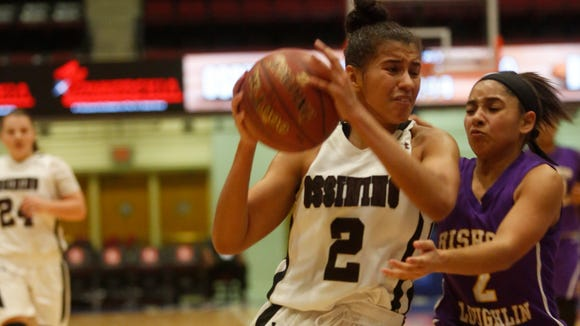 Ossining's Andra Espinoza-Hunter scored 51 points in the Pride's 86-64 win over Bishop Loughlin in the consolation game at  the 18th Annual Slam Dunk Tournament at the Westchester County Center in White Plains on Thursday. Espinoza-Hunter reached 2,000 points for her high school career and also tied former Ossining star Saniya Chong's single-game scoring record for the tournament