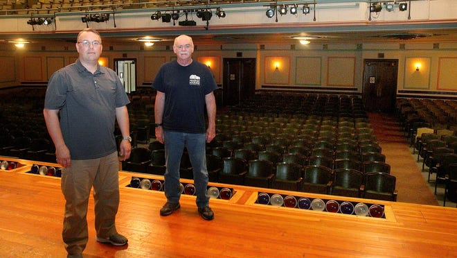 Matt Gibbons, left, and Bill Leser stand on the stage of the auditorium at the Masonic Temple on Wednesday in Freeport. The Masons are raising money to fix the temple's roofs and make other repairs.