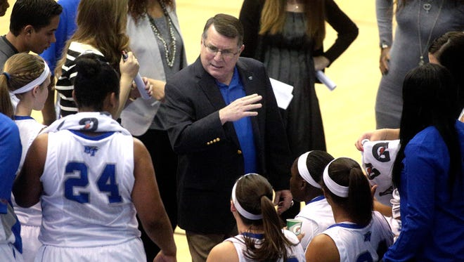 MTSU women's basketball coach Rick Insell (center) released a 28-game schedule for the 2014-15 season on Wednesday.