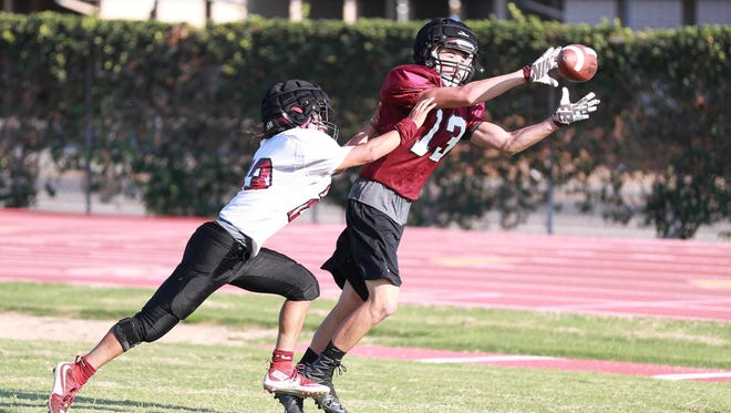 Mt. Whitney's Mason Parker (13) catches pass while be covered by Isaiah Robles.