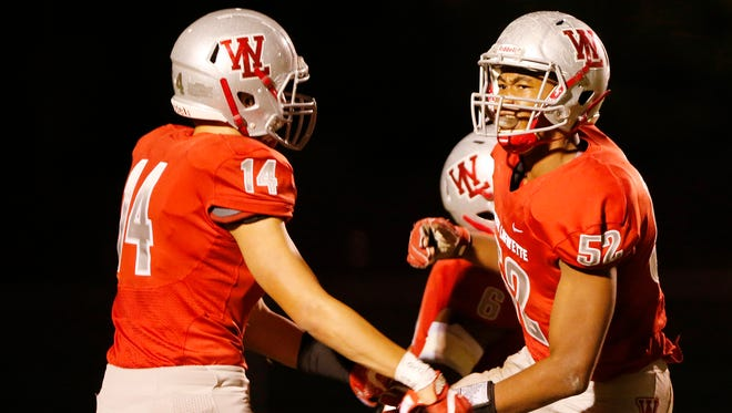 Tavion Woodard, right, of West Lafayette celebrates with teammate Yanni Karlaftis after sacking Tipton quarterback KJ Roudebush in the first half Friday, October 13, 2017, at Gordon Straley Field in West Lafayette. West Lafayette defeated Tipton 51-6 to win the Hoosier Conference title.
