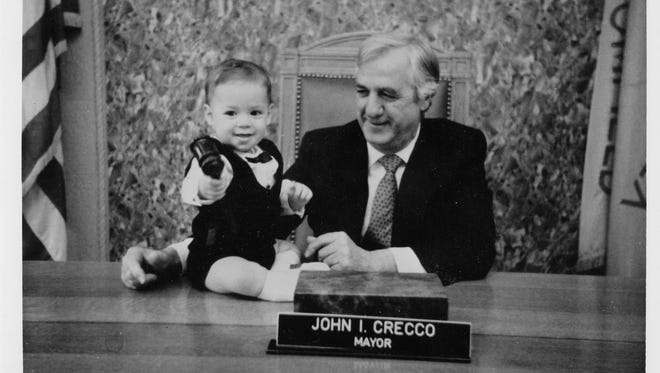 A young Jonathan Cummings, left, with his grandfather, then-Mayor John I. Crecco, in the mayor's office in this undated photo.