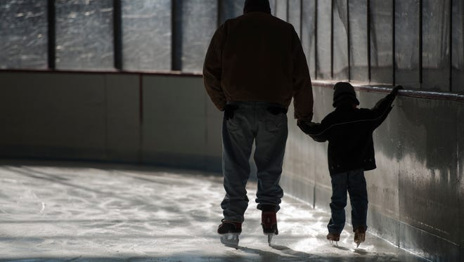 Learning to ice skate at John T. Wright Arena located at Mackay Park in Englewood.