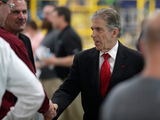 KI Corporation CEO Dick Resch shakes hands with employees