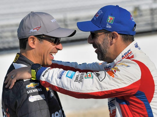 Helio Castroneves ,left, and Tony Kanaan share stories before the first practice for the Indy Grand Prix on Friday, May 11, 2018.