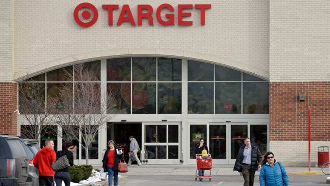 Shoppers leave a Target store in North Olmsted, Ohio on Dec. 19.