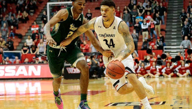 Cincinnati Bearcats guard Jarron Cumberland (34) drives down the court in the second half of the American Athletic Conference game between the Cincinnati Bearcats and the South Florida Bulls at UC's Fifth Third Arena in Cincinnati on Sunday, Jan. 29, 2017. The Bearcats extended a winning streak to 12 games with a 94-53 victory over the Bulls.