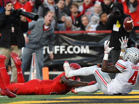 Ohio State's Curtis Samuel got both hands on the ball, but couldn't haul in what would have been a 39-yard touchdown pass from J.T. Barrett in the first half of Saturday's game at Maryland.
