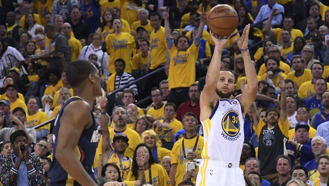Golden State Warriors guard Stephen Curry (30) shoots the basketball against New Orleans Pelicans guard Rajon Rondo (9) during the third quarter in game five of the second round of the 2018 NBA Playoffs at Oracle Arena.