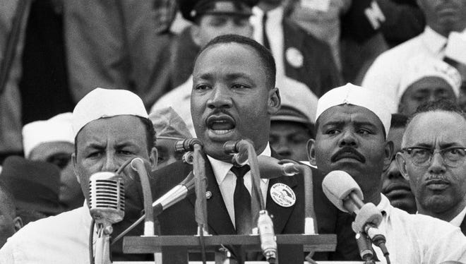 """Martin Luther King Jr. addresses marchers during his """"I Have a Dream"""" speech at the Lincoln Memorial in Washington, Aug. 28, 1963."""