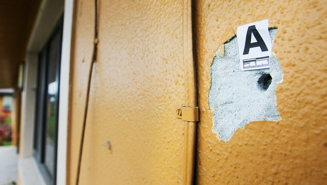 One of several bullet holes is marked on an apartment along the 3000 block of Dora Street in Fort Myers on Saturday. According to the Fort Myers police department, a woman was killed in a drive-by shooting at the apartment early Saturday morning.