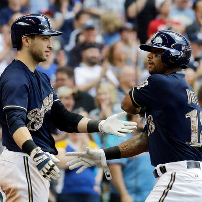 Milwaukee Brewers' Khris Davis is congratulated by Ryan Braun after hitting his second home run of the day during the third inning of a baseball game against the San Francisco Giants Monday, May 25 in Milwaukee.