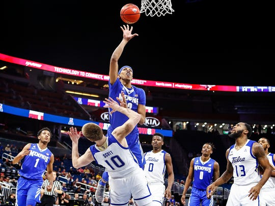 Memphis forward Jimario Rivers (top) drives to the