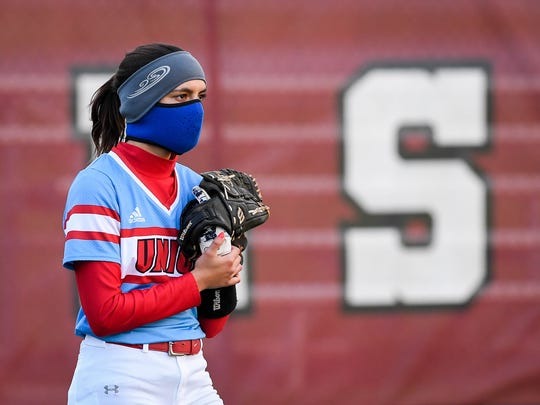 Union County's Annaclaire Johns (5) wears a face-mask against the cold as the Lady Colonels play the Union County Bravettes at Henderson's North Field Tuesday, April 10, 2018.