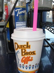 A Dutch Bros Coffee barista changed a grieving woman's life with a pink straw and a few words written on a cup, a woman wrote on a social site.