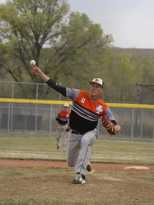 Aztec's Cody Smith delivers a pitch against Kirtland Central on Saturday at Kirtland Central High School.