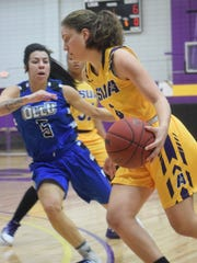 LSUA's Carmen Degeyter (4, right) gets past Our Lady of the Lake's Jessica Montalvo (5, left).