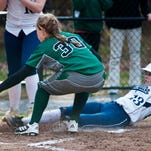 Burlington's Hannah's Schirling (right) steals home ahead of the throw to St. Johnsbury's Taylor Belknap in Burlington on Friday.