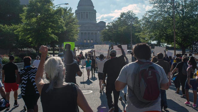Protesters march towards the Arkansas Capitol building on Saturday, June 6, 2020 in Little Rock.