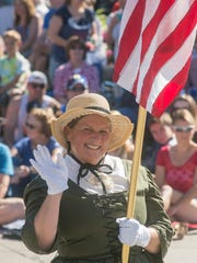 Christy Haradean carries the flag for the Plymouth Historical Museum.
