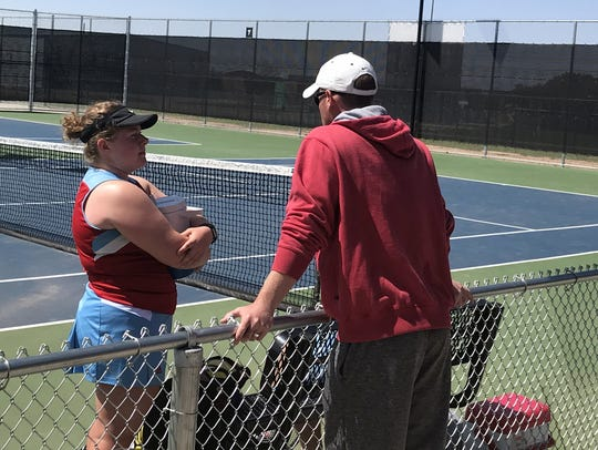 Hirschi coach Lee Gregg coaches the mixed doubles team
