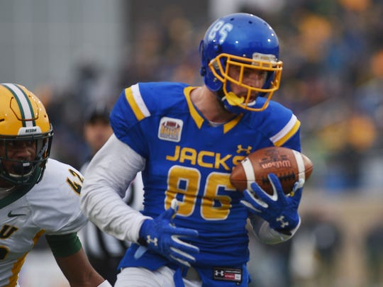 South Dakota State University's Dallas Goedert looks at the ball in his hand after he catches the ball in the end zone during the game against North Dakota State University Saturday, Nov. 4, at Dana Dykhouse Stadium in Brookings.