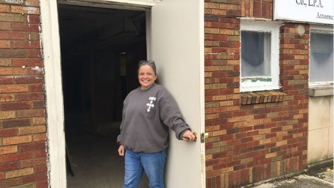 Angie Henke has relocated Reaching Out to 30 S. Mulberry St. and plans to continue to offering Sunday night meals for the homeless and she is adding a washer and dryer and showers to the site for the homeless.