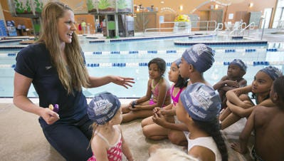 Olympic swimmer Missy Franklin talks to first graders from Percy L. Julian Elementary School in Phoenix during a swim lesson at the Salvation Army Kroc Center in Phoenix on Friday, April 8, 2016.