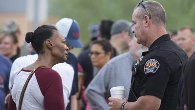 Buckeye Assistant Police Chief Mark Mann talks with Crystal Wilson, the mother of missing 10 year-old Jessie Wilson, on Wednesday, July 20, 2016.