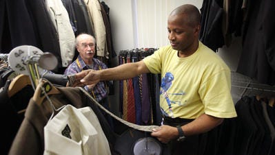 Volunteer Jack Doyle, a retired fitting consultant from Jos. A. Banks, helps retired Army veteran Emmett Taylor, 57, of Camden, N.J., pick out a tie for his new suit that he was getting at Suiting Warriors, Wednesday, March 12, 2014.