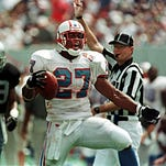 Tennessee Oilers running back Eddie George yells after a run that put the Oilers near the goal line in the 1997 home opener against the Raiders at the Liberty Bowl in Memphis.