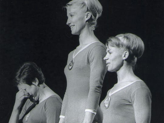 Larisa Latynina, right, on the victory stand at the 1964 Olympics. She finished third in individual parallel bars.