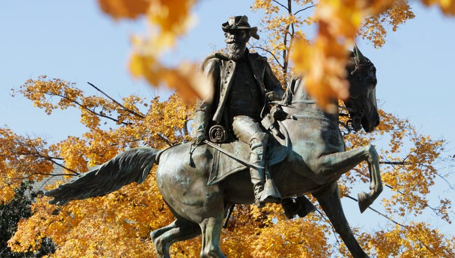 FILE / Leaves displaying fall colors frame the statue of Confederate General J.E.B. Stuart on Monument Ave.  in Richmond, Va., Thursday, Nov. 11, 2010. (AP Photo/Steve Helber)