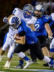 Cedar Crest's Evan Horn tackles Exeter running back