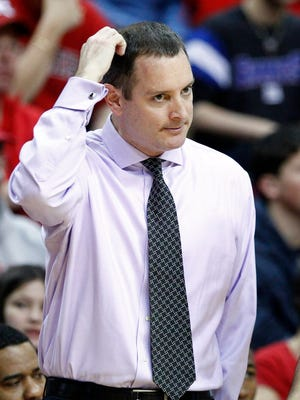 Former Rutgers Scarlet Knights head coach Mike Rice reacts during a game in 2012-13.