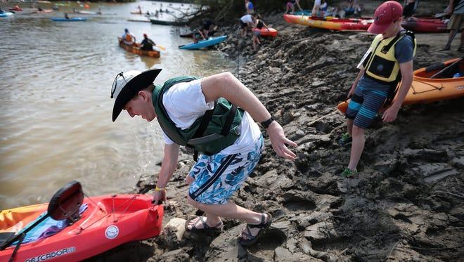 Jeffrey Agre stumbles through the mud while launching his kayak before the 36th Annual Outdoors Inc. Canoe and Kayak Races in Memphis Saturday morning. Some 400 paddlers of all skill levels turned out to traverse the short trip along Mud Island to Mississippi River Park.