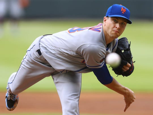 New York Mets pitcher Jacob deGrom throws against the