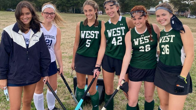 East meets West in the field hockey season opener for both Sturgis teams. Captains for Sturgis East are (from left) Julia Braley and Izzy Coughlin, and from Sturgis West, Isabelle Adams, Maggie Dankert, Sarah Greely, and Charlotte Hagerty.