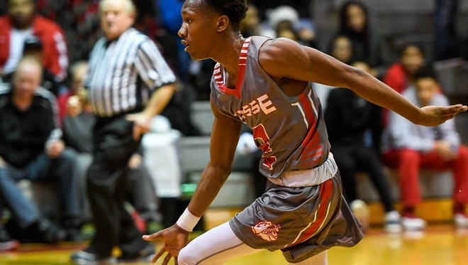 Bosse's Mekhi Lairy drives past the top of the key as the Bosse Bulldogs play Cincinnati Hughes Center in the seventh game of the Bosse Winter Classic at Bosse High Saturday, December 17, 2016.