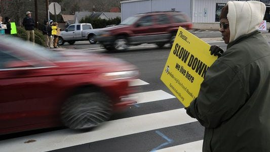 Fatimah Shabazz participates in a rally Saturday on Merrimon Avenue at Coleman Avenue in Asheville to raise awareness about the danger of the intersection. Yvonne Lewis, 67, was killed while crossing the intersection on Jan. 8.