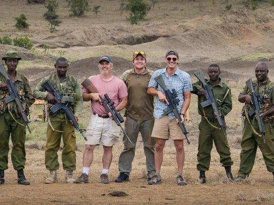 Jim Koenigsaecker poses with anti-poacher rangers in Kenya.