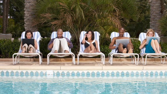 For many business travelers, completely unplugging during vacation is tough to do.