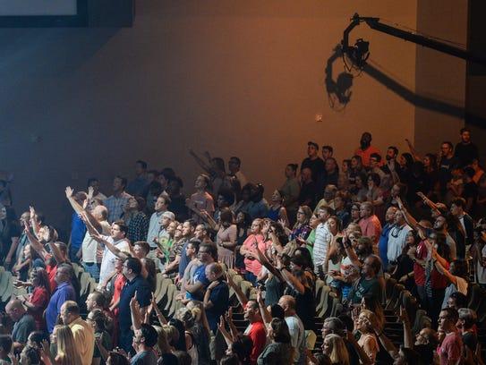 NewSpring church members sing during a church service