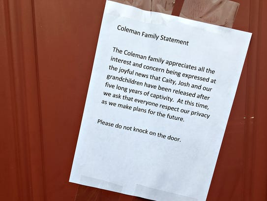 A statement is posted on the door of the home of Caitlan
