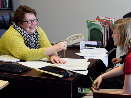 Theresa Berendes Principal at Resurrection School jokes with Elise Collins an eighth grade student during a tutoring session at the school in Evansville last year. Berendes was selected as an outstanding principal finalist this year and last.