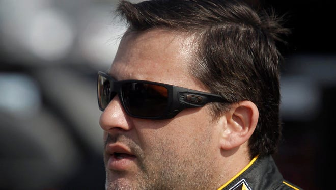 NASCAR Sprint Cup driver Tony Stewart (14) during practice for the Toyota Owners 400 at Richmond International Raceway.