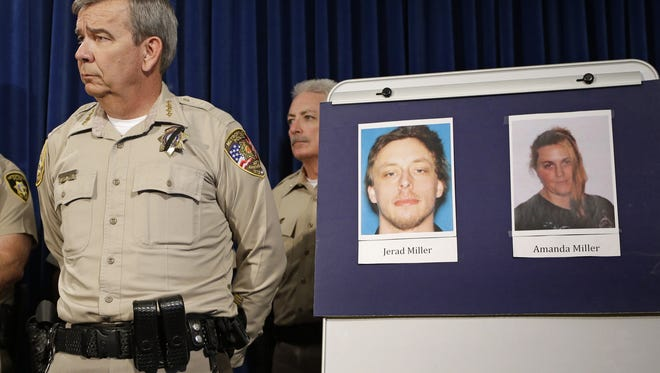 Las Vegas Metropolitan Police Department Sheriff Doug Gillespie stands by pictures of Jerad and Amanda Miller during a news conference Monday, June 9, 2014, in Las Vegas.